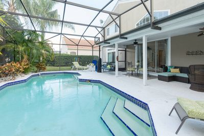 Beautiful pool patio with table and lounge chairs. Toys & life vests included