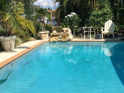 Photo for Waterfront Home with Heated Saltwater Pool & Spa Beautiful Tropical Gardens