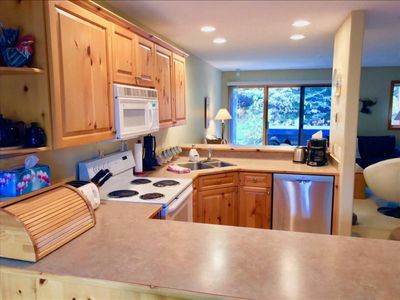 Photo for Deluxe Ski in/out 2 Bed 1200 Sqft Townhouse with Priv. Hot Tub, Garage & Wifi