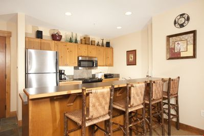 Cook meals in the fully-equipped kitchen, complete with stainless steel appliances