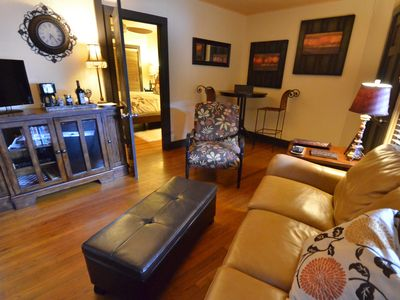 Living area includes leather sleeper sofa, mini fridge, DVD player and Wi-Fi