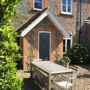 Photo for 10 minute walk into Holt - a lovely house with parking & private lawned garden