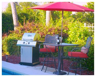 Outdoor pool side seating with gas grill