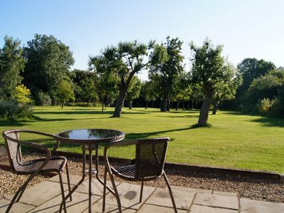 Enjoy a coffee overlooking the orchard