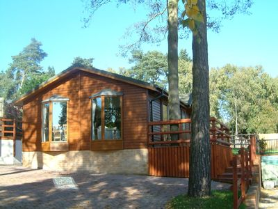 Photo for Beautifully appointed lodge in a park setting near the New Forest