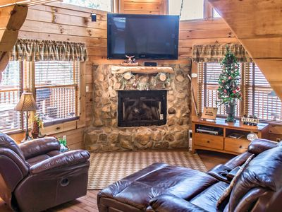 Photo for Charming cabin in private gated community, replete with hot tub, wrap-around deck and WiFi