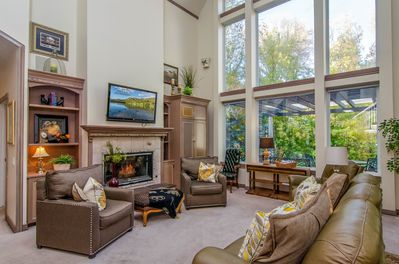 Great Room - - A wall of windows, fireplace, TV and views