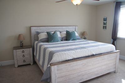 Master bedroom with king bed, memory foam mattress, walk-in closet