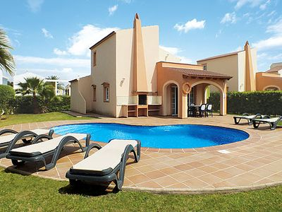 Photo for 3 bedroom Villa, sleeps 6 in Cala Blanca with Pool, Air Con and WiFi