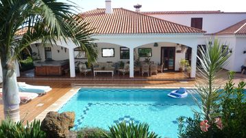 Luxury Villa, heated pool, Sea and Mountain views in a tranquil garden setting.