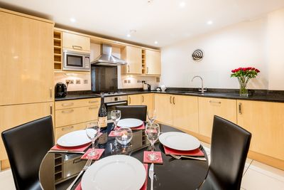 Sleek modern kitchen, ideal for dining at home