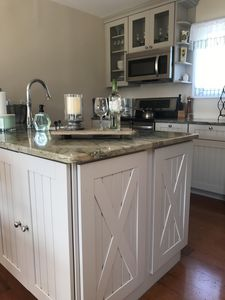 Gorgeous granite kitchen island for cooking and serving.