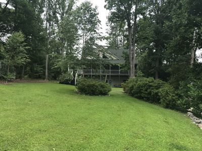 view of house from yard close to lake