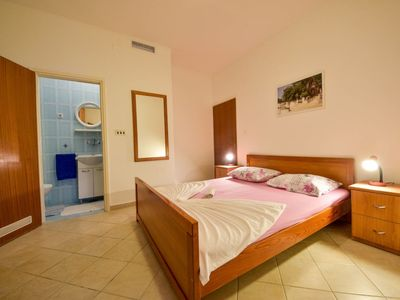 Photo for Apartment 569 m from the center of Preko with Parking, Internet, Air conditioning, Pool (113549)