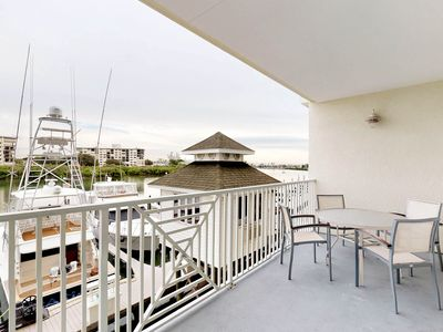 Photo for NEW LISTING! Cozy condo w/ balcony, full kitchen, & shared pool - near the beach