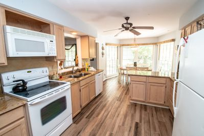 Kitchen has all you need, utility room including washer and dryer right next to it.