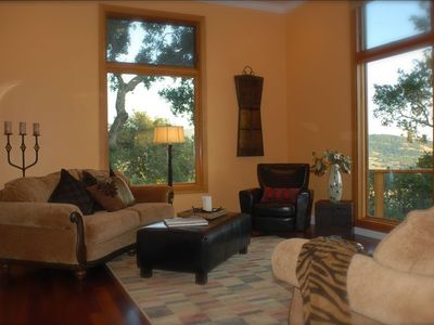 Living room with warm colors, expansive windows