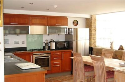 Well-Appointed Kitchen with Large Fridge/Freezer and Dining Area