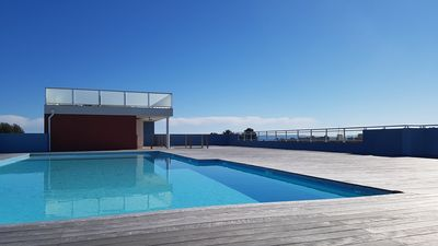 Photo for Residence with swimming pool on the roof / nice studio 25m² / secure private garage / ...