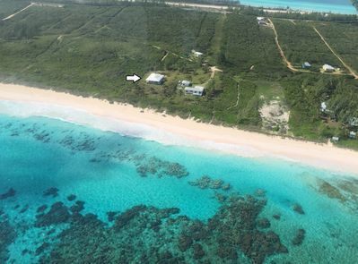 Aerial View - Atlantic Sunrise beachfront home on a spectacular and pristine pink sand beach