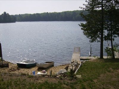 Enjoy the sandy beach and the large dock for fishing, swimming or boating