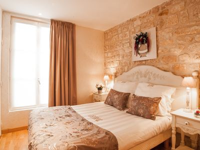 Photo for Quintinie Champagne apartment in 15ème - Seine with WiFi, integrated air conditioning & lift.