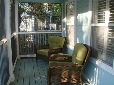 Enjoy your conversations on the lovely screened front and side porches