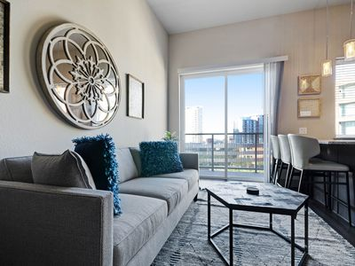 Photo for NEW LISTING! Chic condo located in city center w/balcony, shared pool/gym