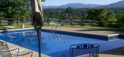 Enjoy a panoramic view of the Blue Ridge mountains from the private pool