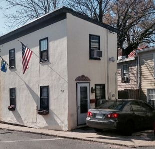 Photo for Delightful little Historic District gem is furnished primarily with antiques that have been in the owner's family for generations