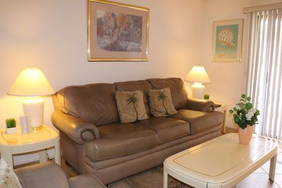 Leather love seat and sofa in the living room