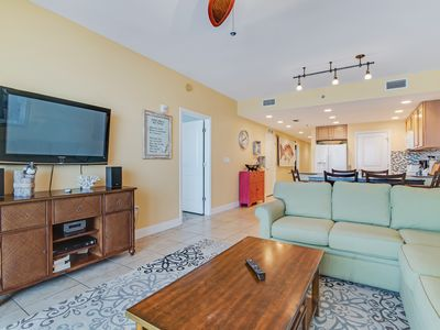 Photo for Gorgeous beachfront condo with free WiFi + shared pool/ hot tub - near waterpark
