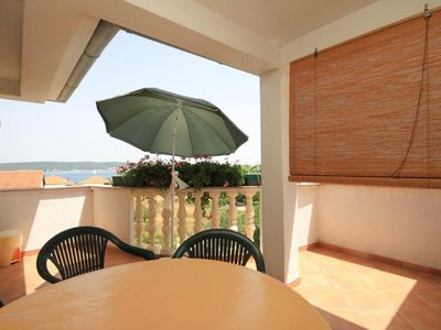 Photo for Two bedroom apartment with terrace and sea view Neviđane, Pašman (A-8273-a)