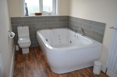 Main Bathroom with Two Person Spa Bath separate shower cubicle.