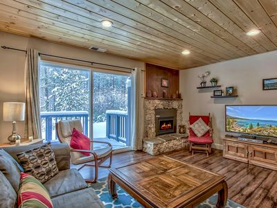 A nice cozy living room with cable tv, thermostat gas fire place and board games