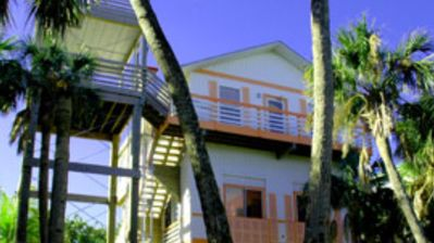 Gorgeously-appointed 4-bedroom beach home steps away from pristine beaches.