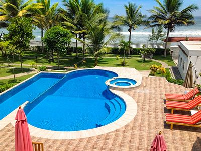 Photo for Beachfront, large Pool, lap pool, & Jacuzzi, Barbecue  area, Spectacular Gardens