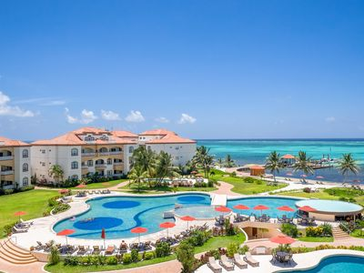 Photo for 5 Star Beach Front Luxury Resort Grand Caribe * Newly Updated* FREE Bikes!