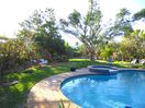 The large garden and pool area are shared with 2 other apt's