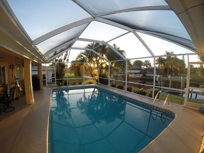 Photo for Spacious Comfy Heated-Pool Home/Gulf Access/Southern Exp/4 bdrms/Wifi/Lifts