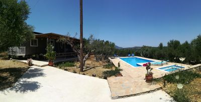 Photo for Hakuna Matata Holidays wooden caravan with AC & swimming pool in Olive Grove