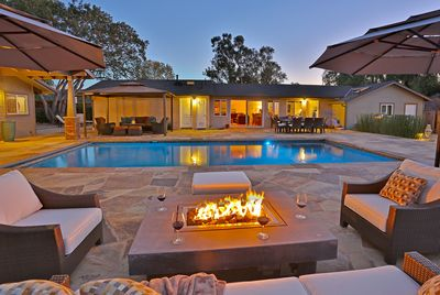 Pool Terrace at night by the firepit