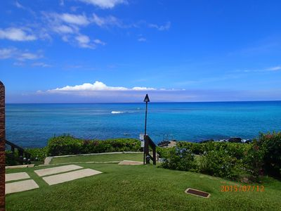 View of ocean, tiki torch and path to the snorkel ladder from the condo