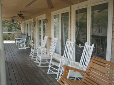 Front Porch with rocking chairs and swing.