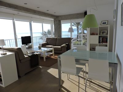 Photo for Sunny apartment in 1st line with views and private access to the beach