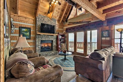 The living room features mountain-motif decor, a gas fireplace and Smart TV!