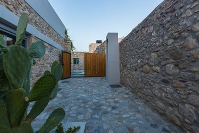 Stone paved terrace that leads to the entrance of the villa!