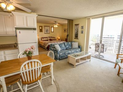 Photo for This lovely tenth floor condo has sweeping views of the island from your balcony. Unit 1001A is just steps to the pristine, white sandy beach located outside your back door.