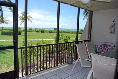 View of Gulf of Mexico from the lanai with beach chairs/umbrella and sand toys