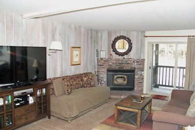 Mammoth Condo Rental Chamonix 53 - Living Room with Woodstove and Outside Deck Access